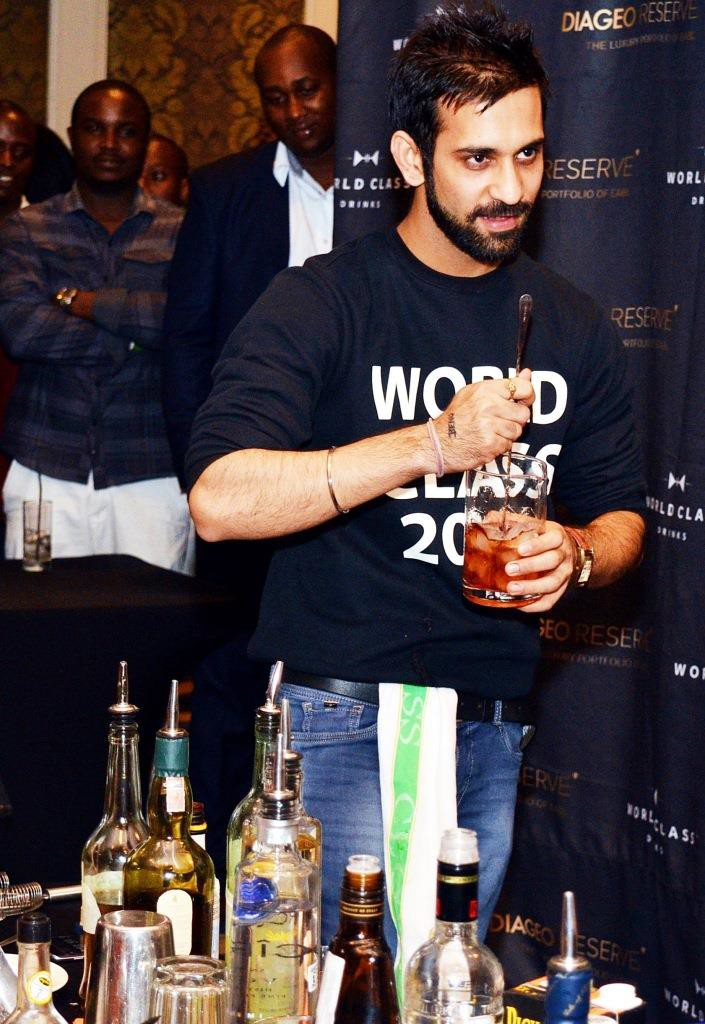Second Runner Up of the WORLD CLASS Kenya Bar tending competition creating one of his signature cocktails during the finals