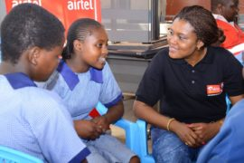 Airtel Kenya's Irene Nkenchi engages with a group of students from St  Bakhita Primary School during the mentorship program
