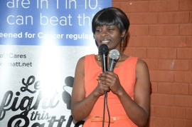 Joyce Wawira, Cancer Survivor speaks to the audience