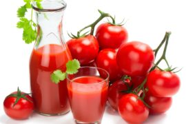 tomatoes and tomato juice on white background