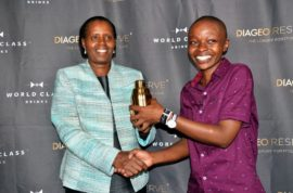 WORLD CLASS Bartender of The Year Samia Joan receives the gold shaker from KBL Managing DIrector Jane Karuku